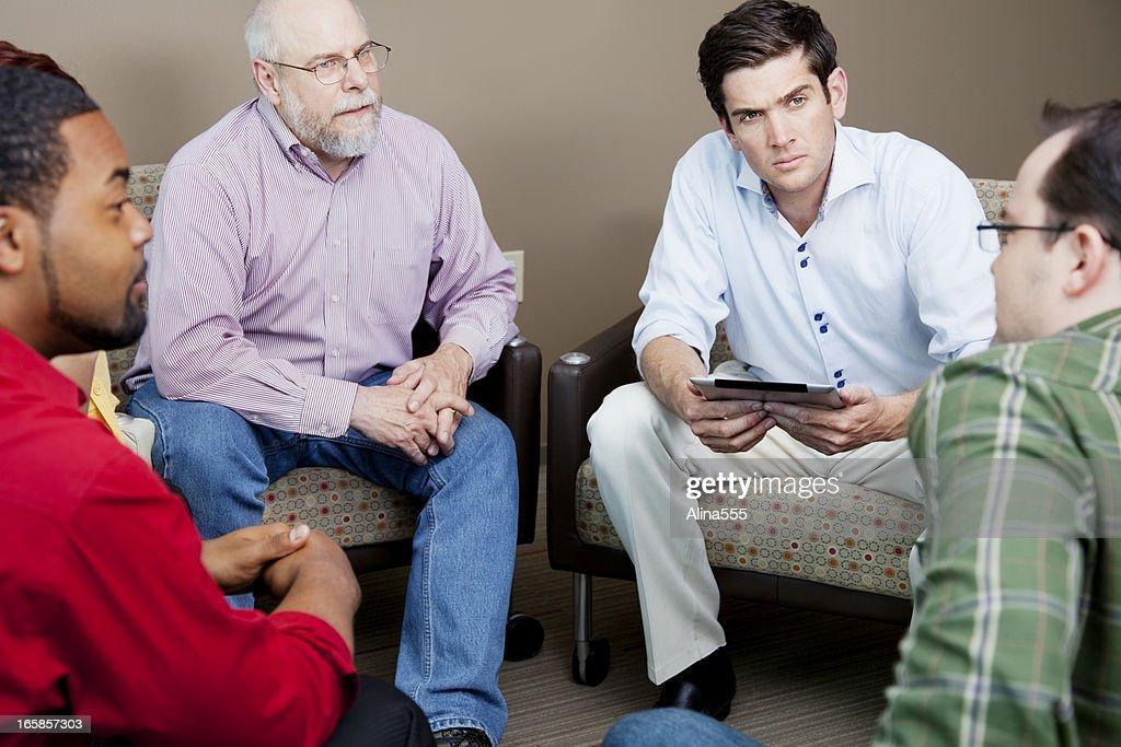 Serious team business meeting : Stock Photo