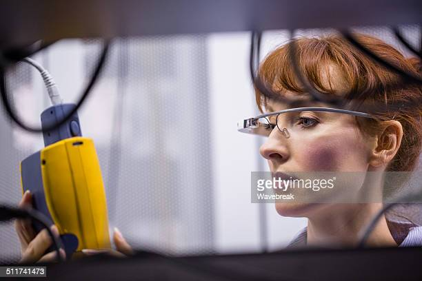 Serious technician working on a server