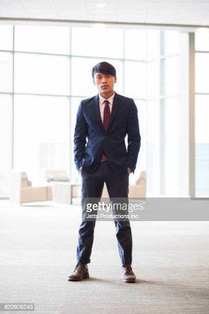 serious vietnamese businessman in office - back lit stock pictures, royalty-free photos & images