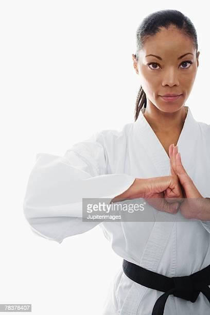 Serious woman doing martial arts