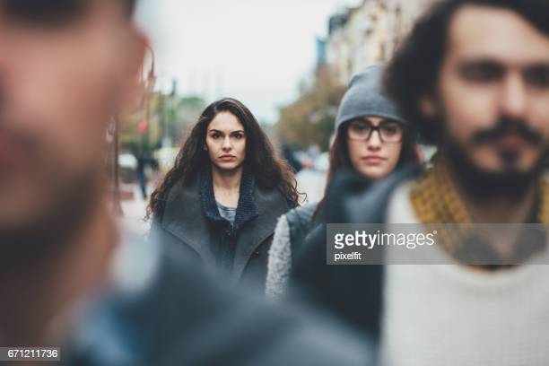 serious woman in the crowd - image focus technique stock pictures, royalty-free photos & images