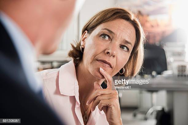Serious woman looking at businessman