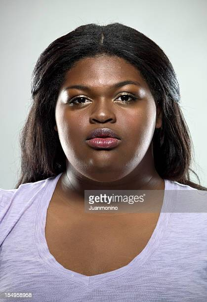 serious woman - images of fat black women stock photos and pictures
