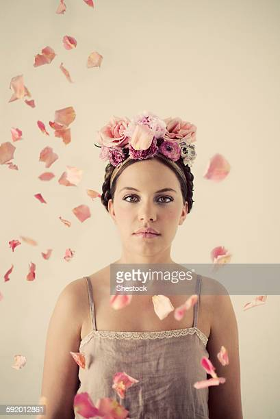 Serious woman wearing flowers in her hair