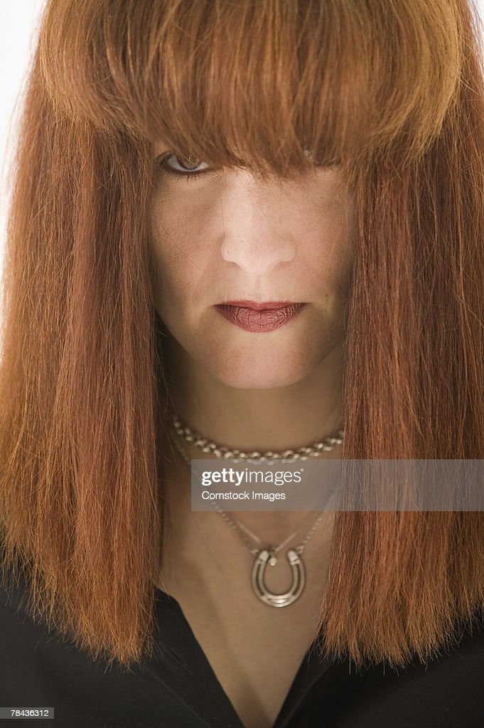 Serious woman with hair in face : Stockfoto