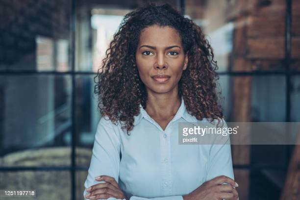 serious young african-american businesswoman - social justice concept stock pictures, royalty-free photos & images