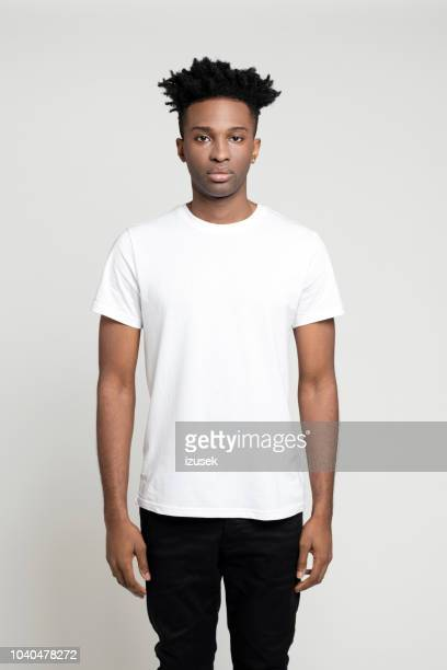 Serious young afro american man standing in studio