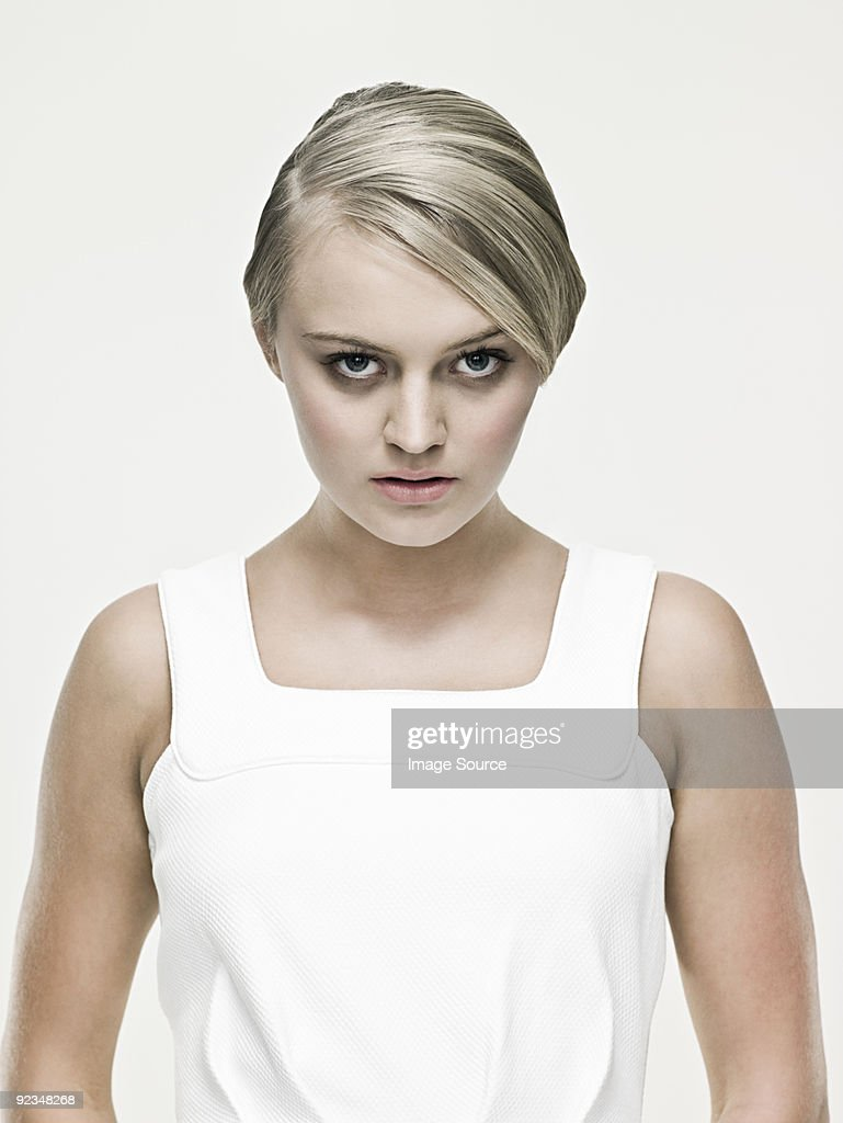 Serious young blond woman : Stock Photo