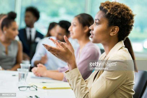 Serious young businesswoman participates in panel discussion