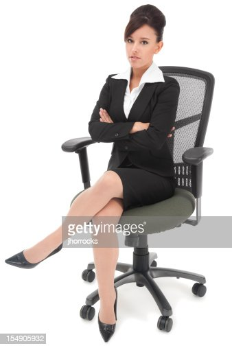 Serious Young Businesswoman Sitting In Office Chair Stock