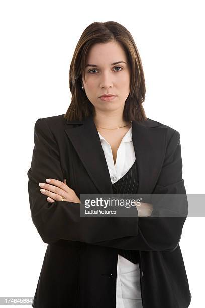 Serious young female wearing jacket arms crossed