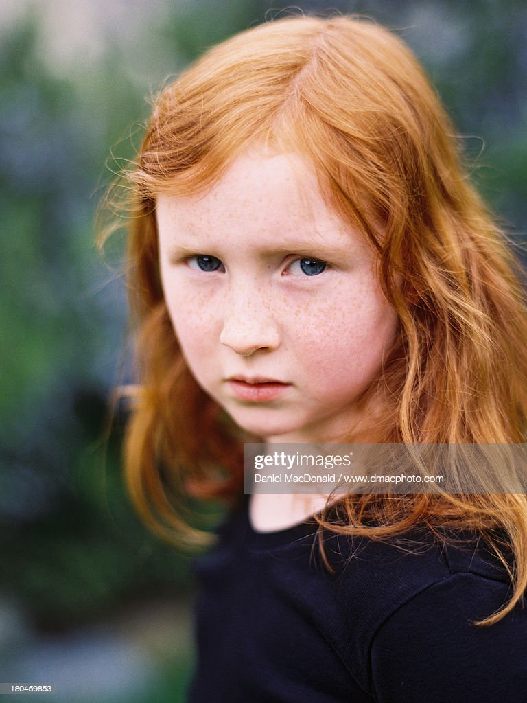 young girl with red hair stock photo image of forest serious young girl with long red hair high res stock photo