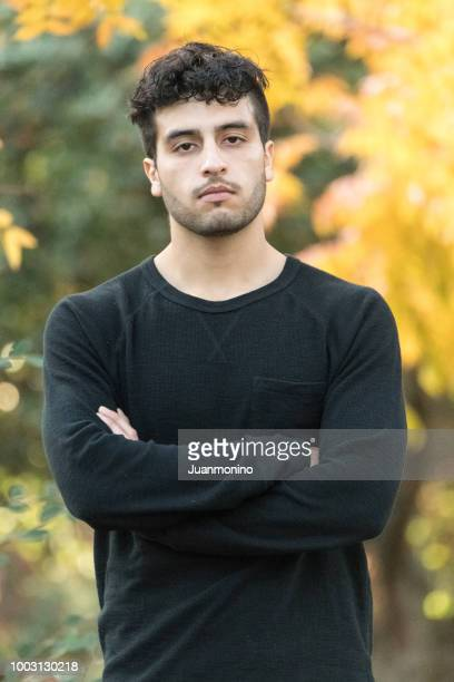 serious young man - handsome pakistani men stock photos and pictures