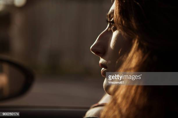 serious young woman in car - atmospheric mood stock pictures, royalty-free photos & images
