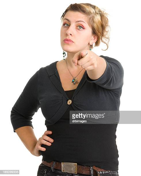 serious young woman pointing at camera - pointing at camera stock photos and pictures