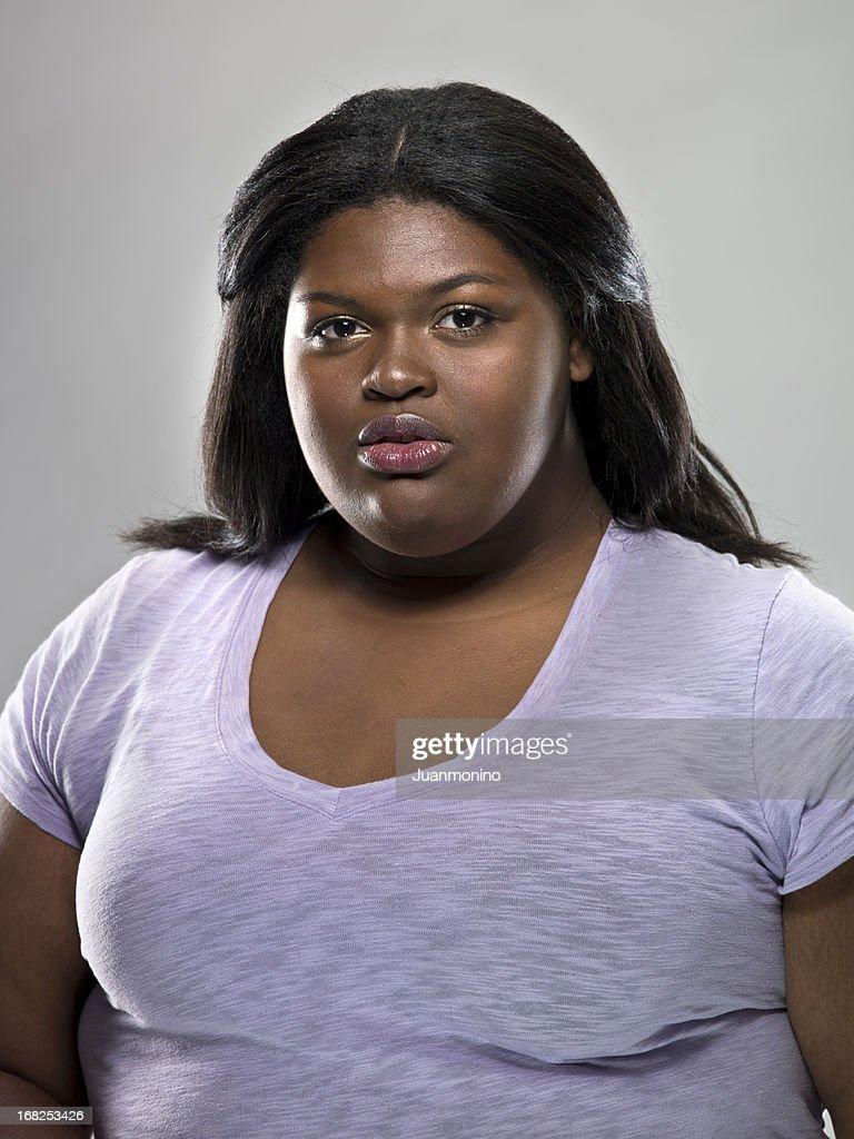 A Serious-Faced Caribbean Woman : Stock Photo