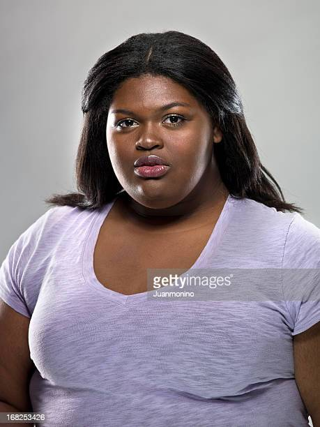 a serious-faced caribbean woman - images of fat black women stock photos and pictures