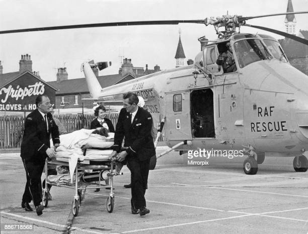 A seriously injured patient airlifted to Hull Royal Infirmary is wheeled from a RAF Westland Whirlwind 5th November 1969