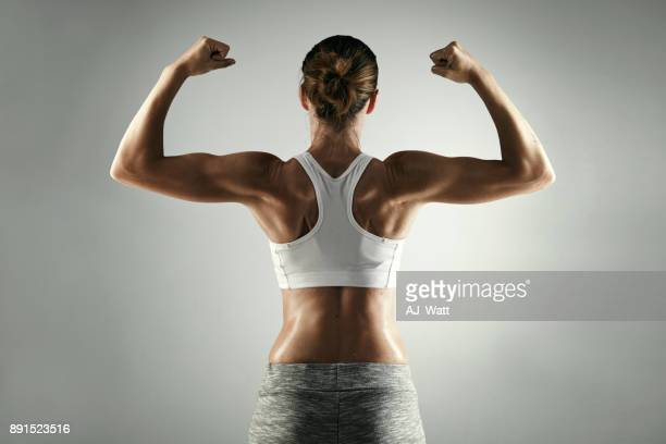 seriously strong - flexing muscles stock pictures, royalty-free photos & images