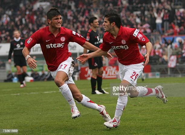 Serkan Calik celebrates with his team mate Baris Ozbek after scoring the third goal of Essen during the Second Bundesliga match between Rot Weiss...