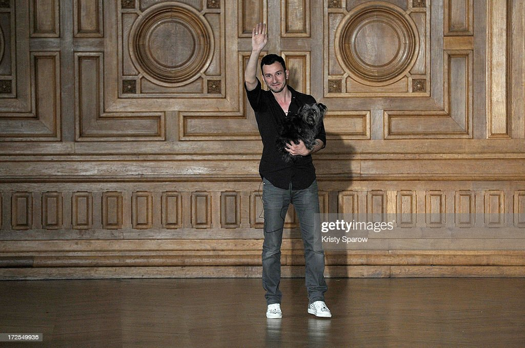 Serkan Cura acknowledges the audience during the Serkan Cura Couture show as part of Paris Fashion Week Haute-Couture Fall/Winter 2013-2014 at Mairie du 4e on July 3, 2013 in Paris, France.