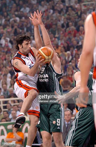 Serkan Erdogan of Tau Ceramica tries to pass out of trouble as Mike Batiste of Panathinaikos tries to block during the Euroleague Final Four Semi...