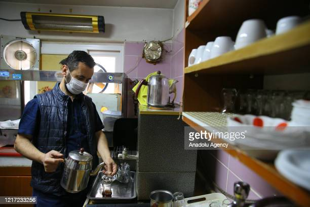 Serkan Serdaroglu, who has been operating a tea house for 7 years, is seen at work on the third day of normalization process in Izmir, Turkey on June...