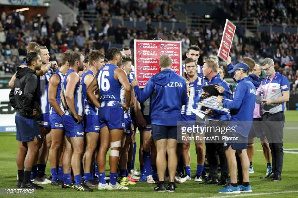 Sernior coach David Noble of the Kangaroos addresses his players during the 2021 AFL Round 05 match between the Geelong Cats and the North Melbourne...