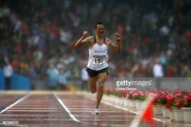 Serod Batochir of Mongolia runs to the finish line to win the men's competition of 'Good Luck Beijing' 2008 Beijing International Marathon Race at...