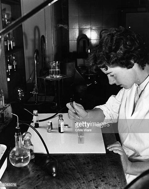 Serologist tests blood samples of recent victims as part of the fight against crime at New Scotland Yard, headquarters of the Metropolitan Police.