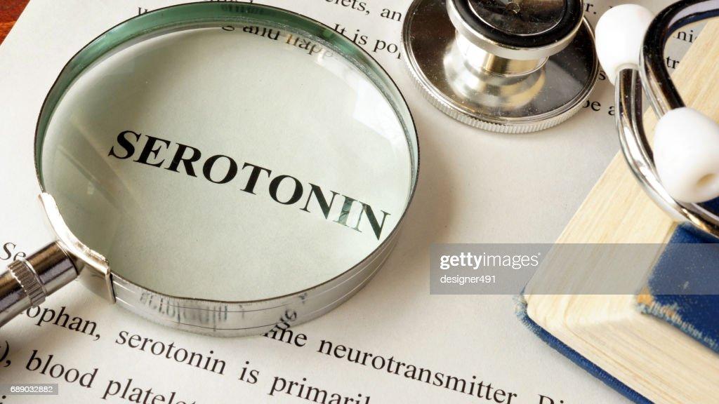 Serotonin written on a page. Human hormones. : Stock Photo