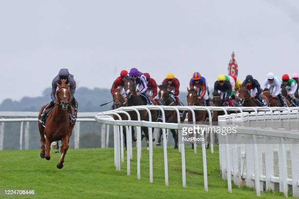 Serpentine and EJ McNamara with a clear lead in The Derby from the outset on Epsom Downs, south of London on July 4 during the 241st Epsom Derby...
