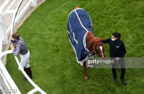 Serpentine and Emmet McNamara in the winners enclosure after victory in the Investec Derby at Epsom Racecourse on July 04 2020 in Epsom England The...