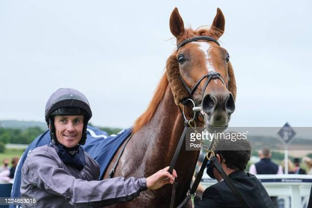 Serpentine and Emmet McNamara reacts after winning The Investec Derby at Epsom Racecourse on July 04 2020 in Epsom England The famous race meeting...