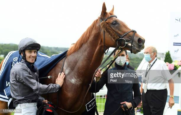 Serpentine and Emmet McNamara win the Derby at Epsom Racecourse on July 04 2020 in Epsom England The famous race meeting will be held behind closed...