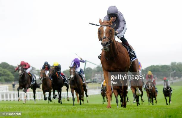 Serpentine and Emmet McNamara win the Derby at Epsom Racecourse on July 04, 2020 in Epsom, England. The famous race meeting will be held behind...