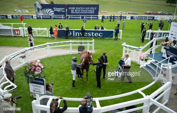 Serpentine ridden by Emmet McNamara celebrate in the winners circle after the Investec Derby at Epsom Racecourse on July 04 2020 in Epsom England The...