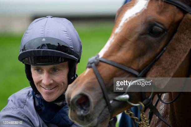Serpentine ridden by Emmet McNamara in the winers circle after the Investec Derby at Epsom Racecourse on July 04 2020 in Epsom England The famous...
