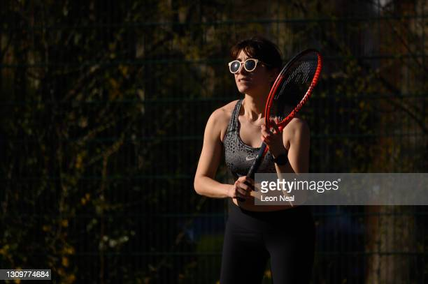 Serra Pakalin awaits the serve during a game at Priory Park tennis courts on March 29, 2021 in London, England. Today the government eased its rules...