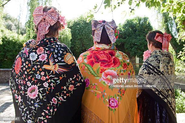 Serranas dressed in embroidered shawls and ties typical Almonaster pilgrimage. Traditions and Festivities in Spain, Pilgrimage of Almonaster, Cruces...