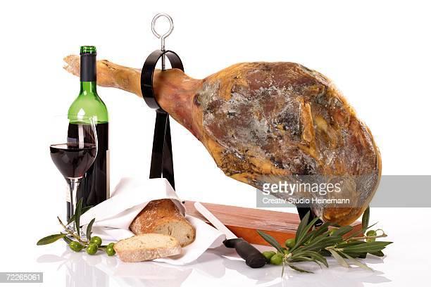 serrano ham and red wine, close-up - serrano ham stock photos and pictures