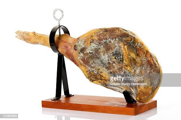 serrano ham in holder, close-up - serrano ham stock photos and pictures