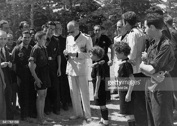 Serrano Suner Ramon Politician Spain*president of the Junta Politica in uniformvisiting the summer camp his two sons in uniform Published by...