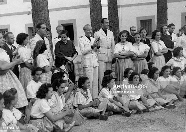 Serrano Suner Ramon Politician Spain*president of the Junta Politica in uniformvisiting the summer camp hoising a flag Published by 'Berliner...