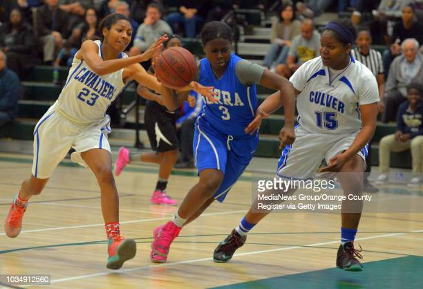 Serra's Cydney Bolton center works her way between Serra's Caila Hailey left and Culver City's Michelle Curry in the South Bay Athletic Club's senior...