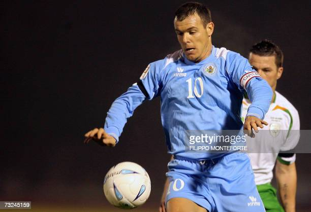 Ireland's Ian Harte fights for the ball with San Marino's Andy Selva during their Euro2008 Group D qualifying match at Serravalle's Olympic stadium...