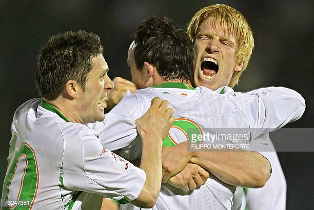 Republic of Ireland's Stephen Ireland jubilates with teamates Paul Mc Shane and Robert Keane after scoring against Republic of San Marino during...