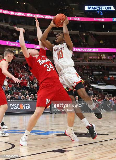 Serrel Smith Jr #10 of the Maryland Terrapins goes up for a shot against Thorir Thorbjarnarson of the Nebraska Cornhuskers at the United Center on...