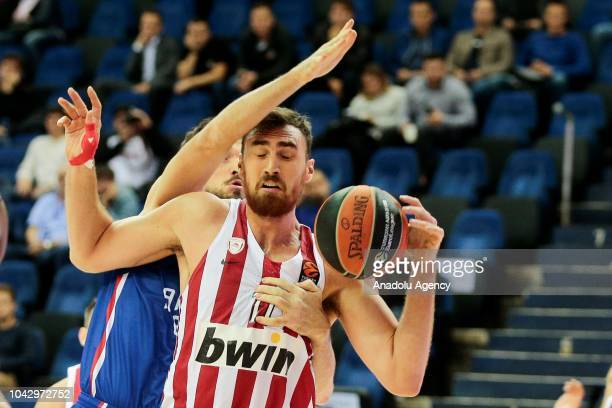 Sertaç anl of Anadolu Efes vies with Nikola Milutinov of Olympiakos during the Alexander Gomelsky's Cup match between Olympiakos and Anadolu Efes in...