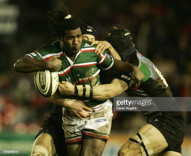 Seru Rabeni of Leicester is tackled by Hal Luscombe and Jim Evans during the Guinness Premiership match between Leicester Tigers and NEC Harlequins...